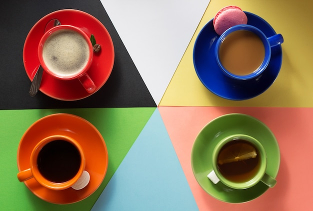Cup of coffee, cacao and tea at abstract colorful