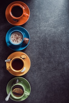 Cup of coffee, cacao and tea at table