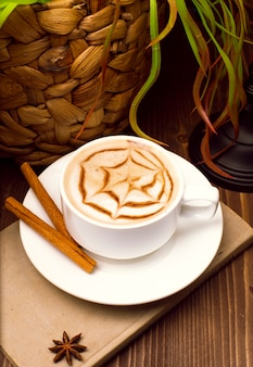 A cup of coffee , cappuccino art , latte art , latte , cappuccino