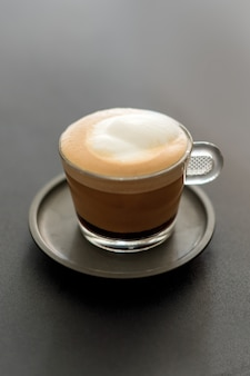 Cup of coffee. cappuccino with foam selective focus