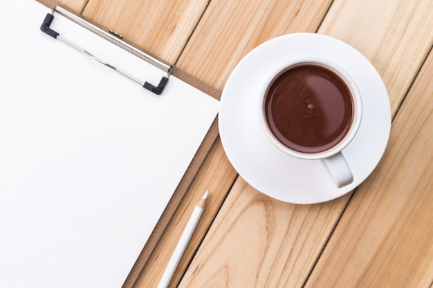 Cup of coffee and checklist