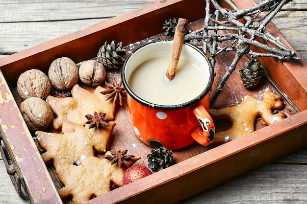 Cup of coffee and christmas symbol in wooden box