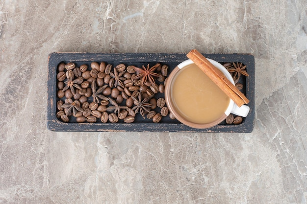 Cup of coffee and coffee beans on dark plate. high quality photo