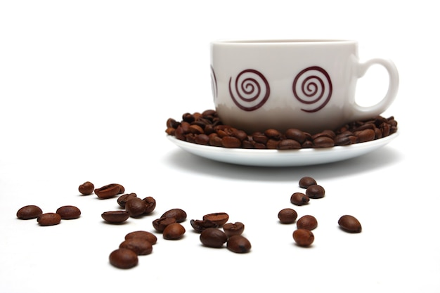 Cup of coffee and coffee beans on a white background
