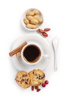 Cup of coffee, cookies and nuts on white background. top view