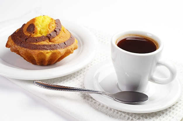 Cup of coffee and cupcake with chocolate