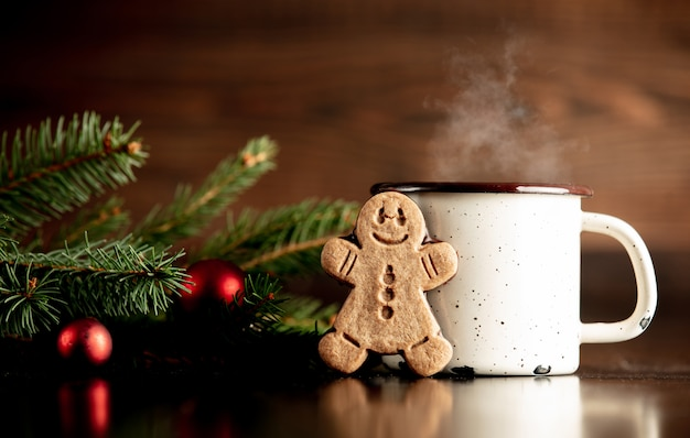 Cup of coffee and gingerbread man cookie