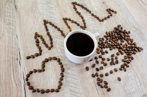 Cup of coffee and heart with diagram with  coffee  beans