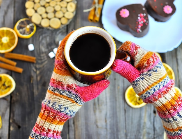 A cup of coffee in his hands,