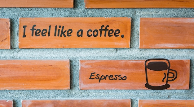 Cup of coffee icon on white brick wall