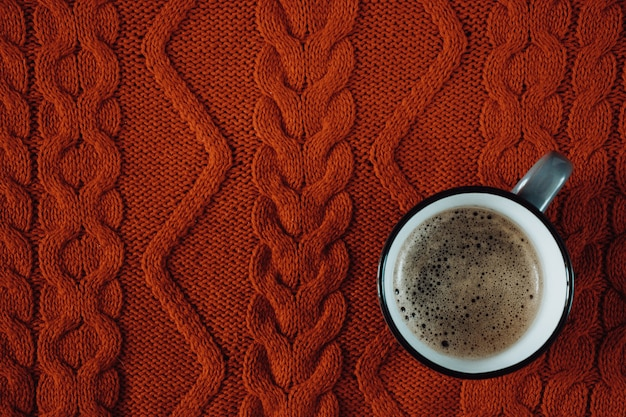 Cup of coffee on a knitted