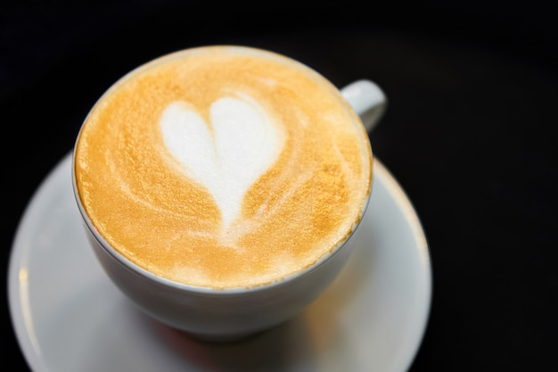 A cup of coffee. latte with heart pattern in a white cup.