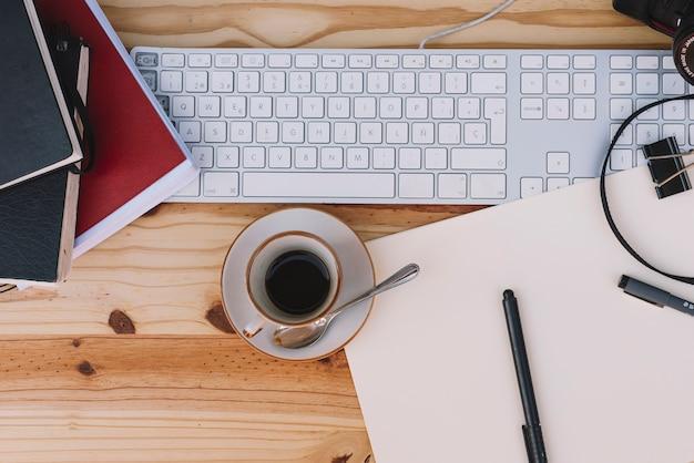 Cup of coffee near keyboard