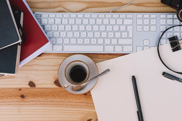 Cup of coffee near keyboard Free Photo