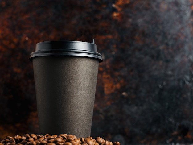 Cup of coffee on a rusty old dark background