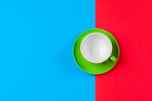 Cup of coffee and saucer on color
