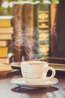 A cup of coffee and a smoke good morning at the office at work. selective focus.