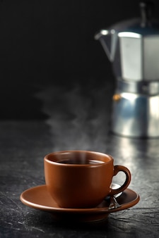 Cup of coffee on a stone background. side view with copy space for your text