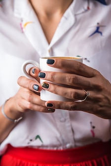 A cup of coffee sutra as a way of awareness and relaxation for a modern girl