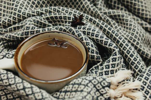 Cup of coffee on table with plaid. high quality photo