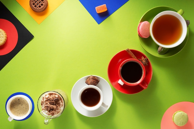 Cup of coffee, tea and cacao at colorful