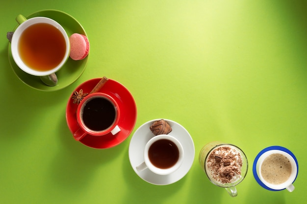 Cup of coffee, tea and cacao at paper colorful