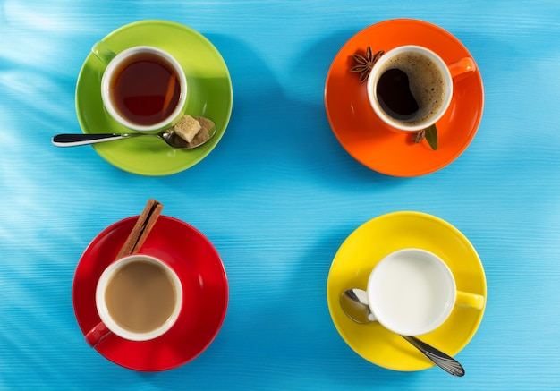 Cup of coffee and tea on wooden