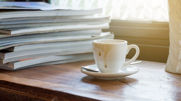 A cup of coffee was put in a stack of a book.