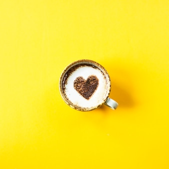A cup of coffee on which the heart is painted