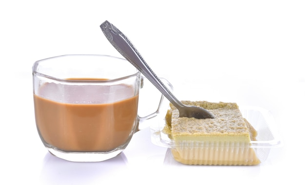 Cup of coffee on a white surface with sugar