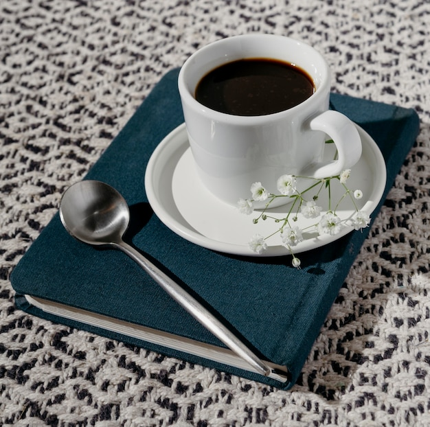 Cup of coffee with agenda Free Photo