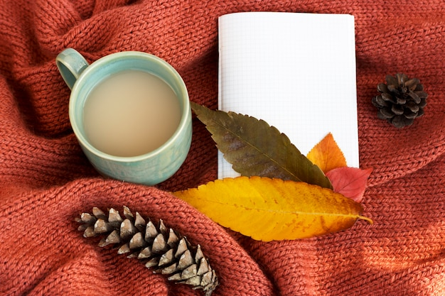 Cup of coffee with an autumn leaf