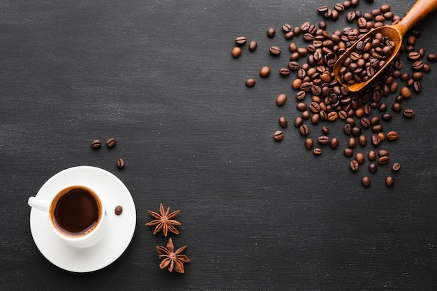 Cup of coffee with beans and anise