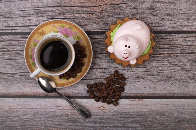 Cup of coffee with beautiful cake