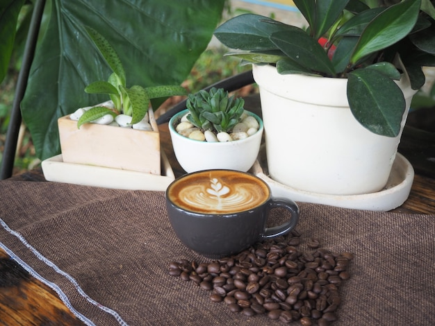 Cup of coffee with beautiful latte art. coffee cup with latte art on the wood table.