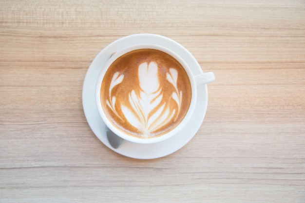 Cup of coffee with beautiful latte art.how to make latte art coffee