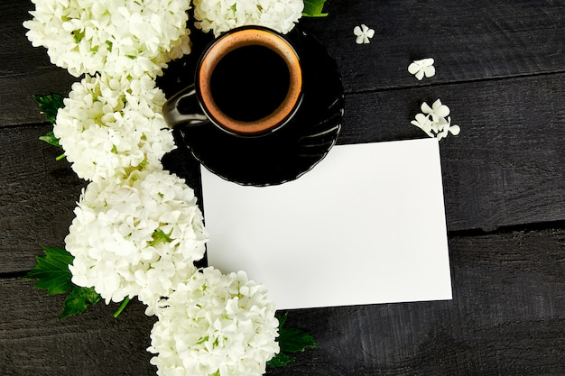 Cup of coffee with bouquet hydrangea