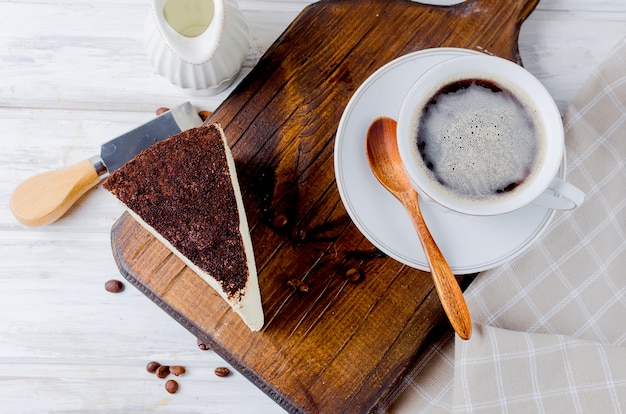 Cup of coffee with cheesecake