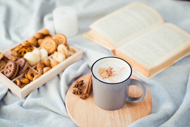 Cup of coffee with cookies and book, autumn still life