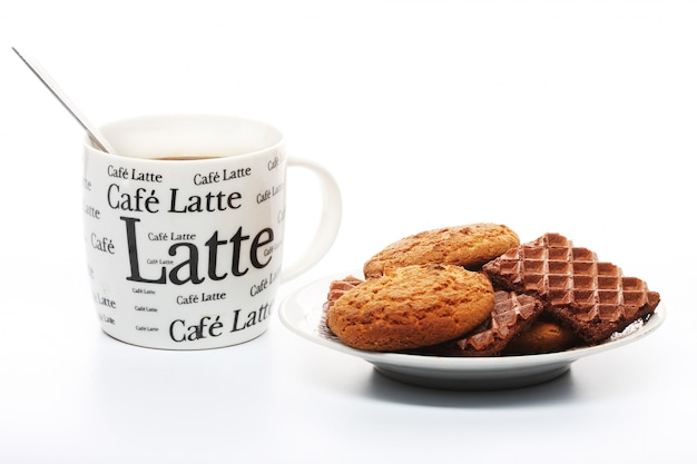 A cup of coffee with cookies over white background