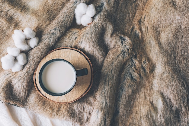 Cup of coffee with cozy blanket, scandinavian style