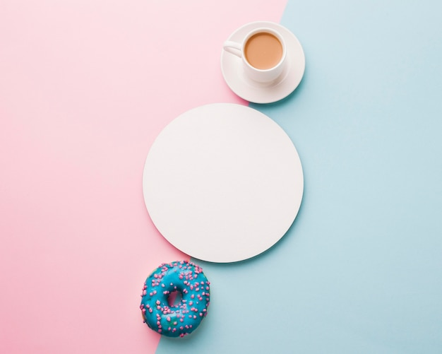 Cup of coffee with doughnut