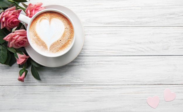 A cup of coffee with heart pattern