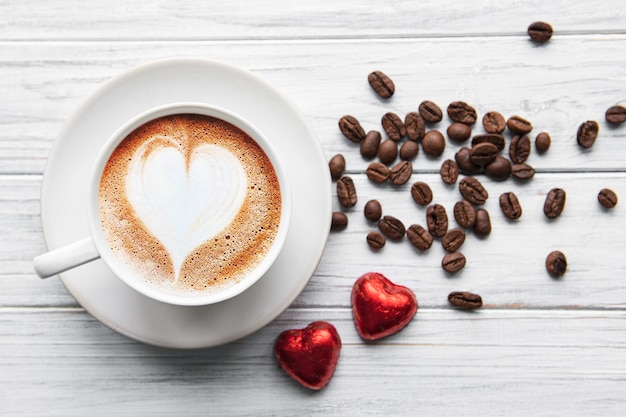 A cup of coffee with heart  on a table
