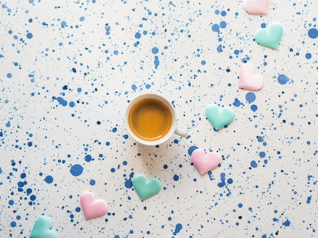 Cup of coffee with little pastel colored hearts