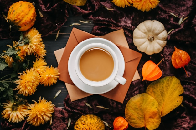Cup of coffee with milk. autumn concept. still life picture