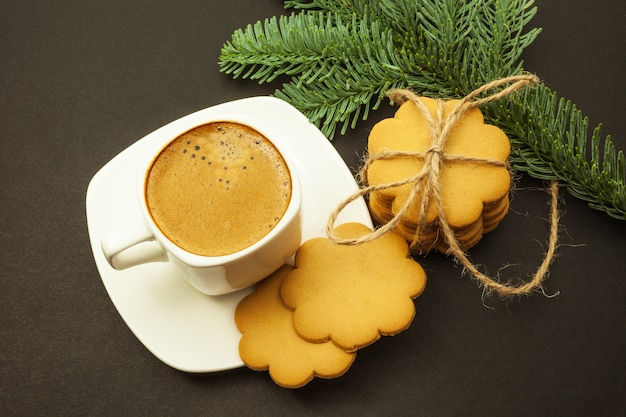 Cup of coffee with milk crema and ginger cookies, christmas morning, top view