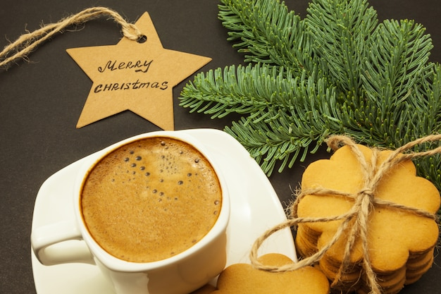 Cup of coffee with milk crema and ginger cookies, christmas theme, top view