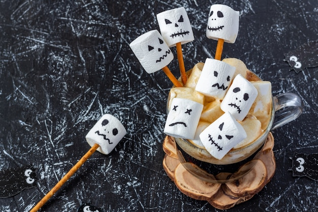 Cup coffee with monsters from marshmallows for halloween