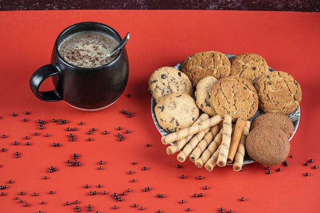 A cup of coffee with oatmeal cookies